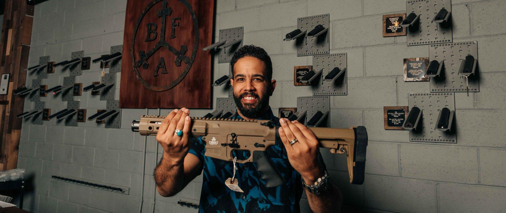 man holding firearm